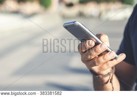 Hand Of Businessman Using While Reading His Smartphone. Portrait Of Hand Of Business Man Reading Mes