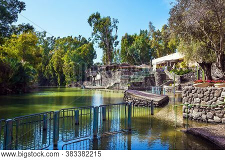 The place of symbolic baptism is equipped with walkways and partitions. The exit of the Jordan River from Lake Galilee. Yardenit, Israel. Religious, ethnographic and photo tourism concept