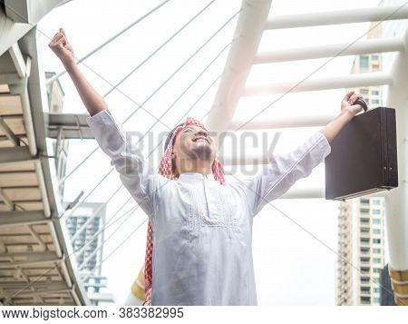 Happy Arab Businessmen Raised Their Fists To Ensure Success In Their Destination. Business Concept