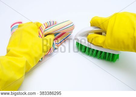 Hands In Yellow Rubber Gloves Cleaning White Surface With A Brush And Wipe, Housecleaning And Housew