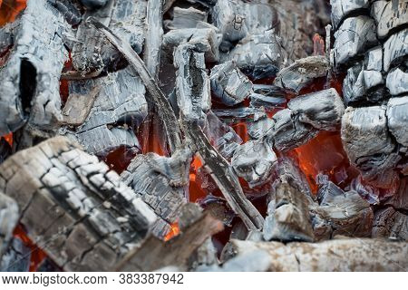 Photo Burning Firewood And Coals.flaming Burning Sparks Close-up, Fire Patterns.view Of Red Hot Glow