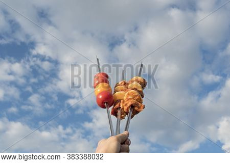 Marinated Meat For Barbecue, Barbecue Or Grill With Onions And Dressed Vegetables On Skewers, The Ph