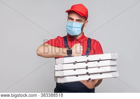 In Time Delivery On Quarantine! Man With Surgical Medical Mask In Uniform And Red T-shirt Standing,