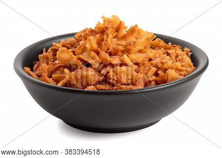 Crispy Fried Onions In A Black Ceramic Bowl Isolated On White.