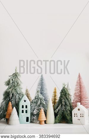 Christmas Little Houses And Trees On White Background. Festive Modern Decor. Happy Holidays. Miniatu