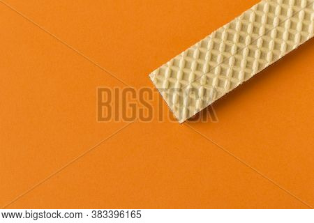 Waffle With Chocolate On Orange Background. Selective Focus. Close Up