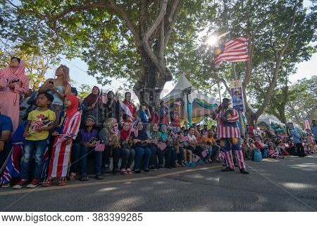 George Town, Penang/malaysia - Aug 31 2017: A Patriotic Malaysia Wear Malaysia Costume And Hold Mala