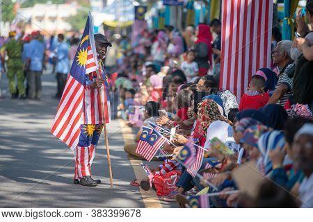 George Town, Penang/malaysia - Aug 31 2017: A Man Hold Malaysia Flag At National Day Parade.