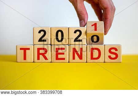 Business Concept Of Planning 2021. Male Hand Flips Wooden Cube And Change The Inscription 'trends 20