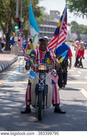 George Town, Penang/malaysia - Aug 31 2017: A Man With Malaysia Flag, Costume, Motor At Street.