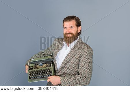 Typewriter. Bearded Journalist Holds A Typewriter. Antiques, Old, Journalist, Secretary, Lawyer, Seo