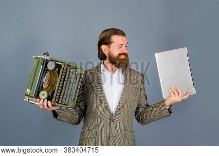 Typewriter Vs Laptop. Bearded Journalist Holds Typewriter And Laptop. Antiques, Old, Journalist, Sec