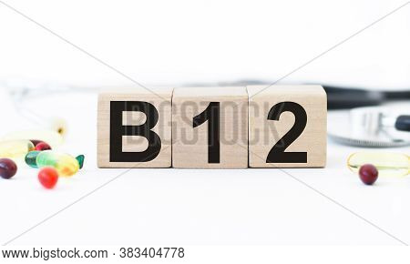 B12 On Wooden Blocks . Vitamin Healthcare And Healthy Living Concept.