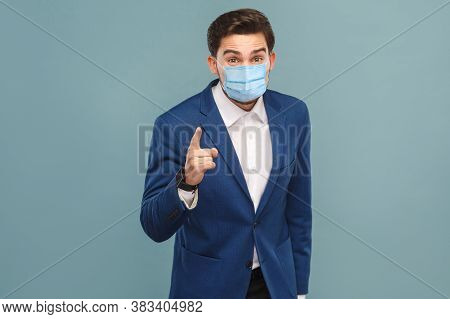 Finaly Warning. Serious Man With Surgical Medical Mask Pointing Finger And Alert You.