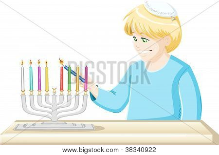 Boy Lights A Hanukkiah Candle
