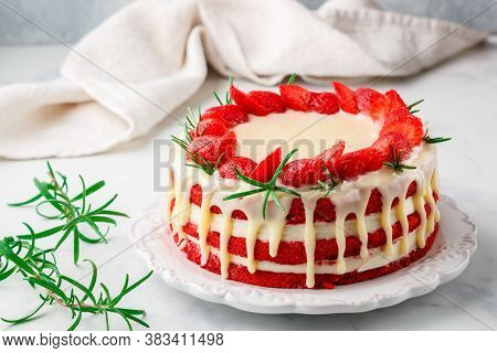 Homemade Red Velvet Cake With White Chocolate,  Fresh Strawberries And Rosemary. Delicious Gourmet D