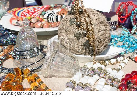 Different Antiques On Flea Market Or Festival - Collectible Glass And Crystal Bells, Vintage Amber A