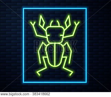 Glowing Neon Line Beetle Deer Icon Isolated On Brick Wall Background. Horned Beetle. Big Insect. Vec