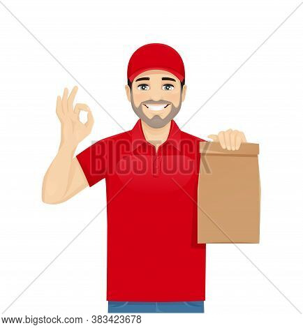 Handsome Delivery Man In Red Uniform Gesturing Ok Sign With Paper Packet Isolated Vector Illustratio