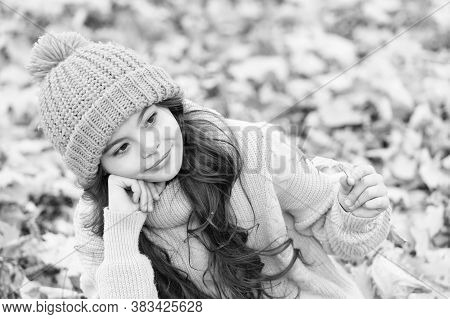 October Is Here Again. Thoughtful Small Girl Collect Fall Leaves On October Day. Little Child Relax