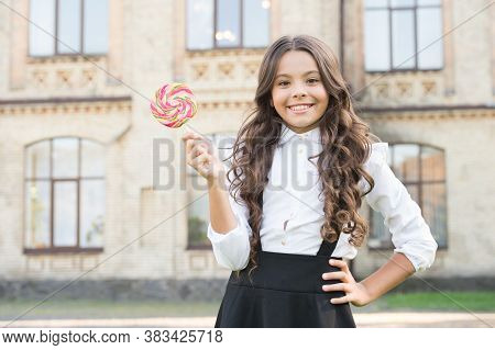 Sweet Joy. Happy Kid With Sweet Candy. Happy Childhood. Kid Child Holding Lollipop Candy. Sweets Con