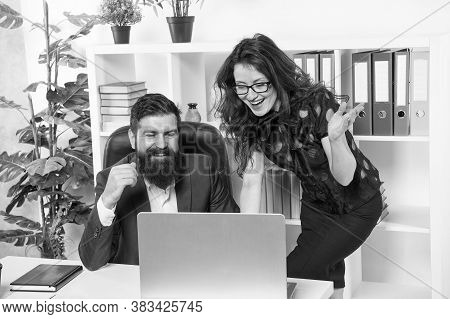 Interacting With Partners Online. Happy Couple Work Online. Bearded Man And Sexy Woman Use Computer.
