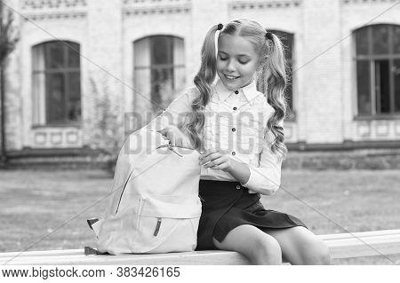 Doing Homework Outdoors. Small Child Do Homework. Little Girl Open School Bag. Homework Assignment.