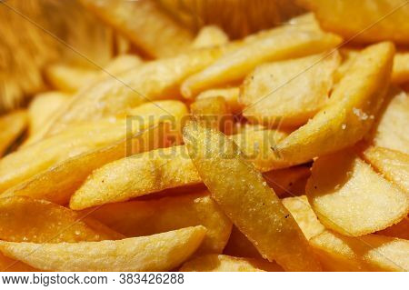 French Fries Background. Yummy Potato Fry Close Up. Fast Food O Street Food Concept.