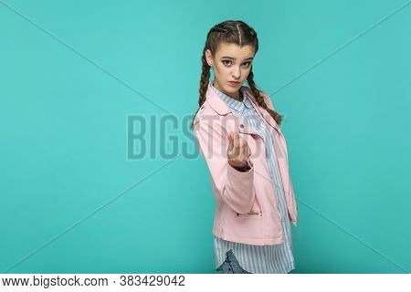 Money Gesture. Portrait Of Beautiful Cute Girl Standing With Makeup And Brown Pigtail Hairstyle In S