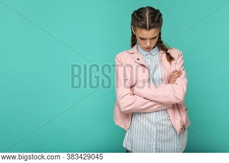 Sad Upset Or Depressed Portrait Of Beautiful Cute Girl Standing With Makeup And Brown Pigtail Hairst