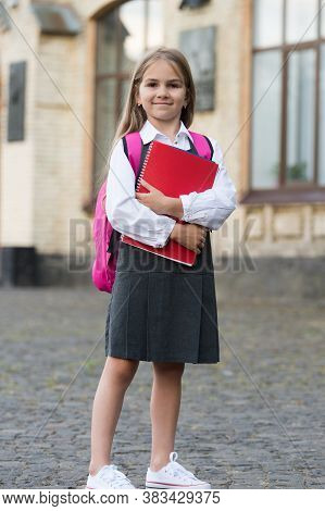 Education Your Door To The Future. Happy Child Hold Books Outdoors. Back To School Supplies. Formal