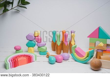 Childrens Wooden Toys In Bright Colors. Toys Made From Natural Materials. Cubes, Rainbow, Rattles, S