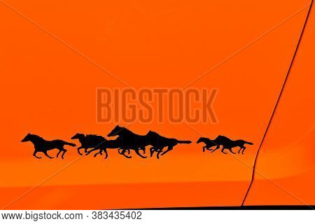 Bismarck, North Dakota, August 1, 2020: The Running Mustangs Logo Represents Ford Mustangs, Displaye