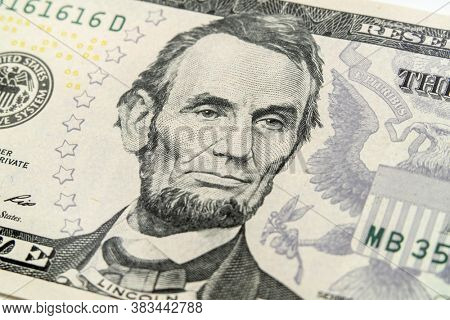Macro view of Abraham Lincoln on the US five dollar bill.