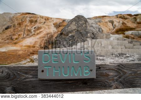Sign For Devils Thumb, A Hot Spring Mineral Formation In Yellowstone National Park