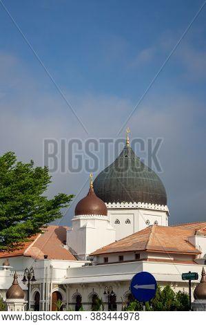 Georgetown, Penang/malaysia - Feb 14 2020: Masjid Kapitan Keling Under Blue Sky.
