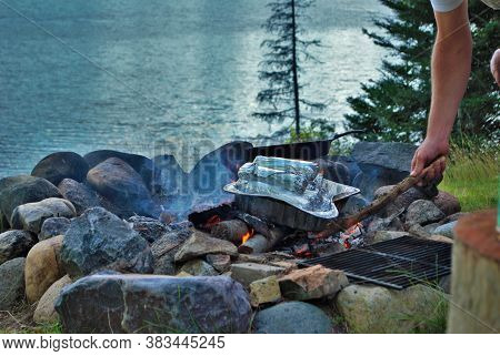 Cooking Corn On A Camp Fire Next To The Lake