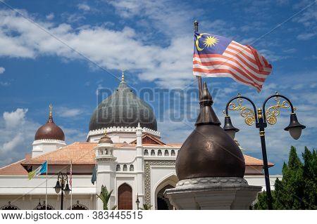 Georgetown, Penang/malaysia - Feb 14 2020: Malaysia Flag And Architecture Masjid Kapitan Keling Mosq