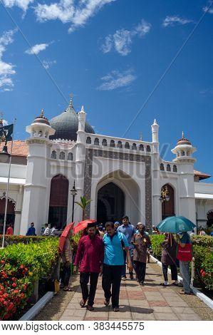 Georgetown, Penang/malaysia - Feb 14 2020: Muslim People At Kapitan Keling Mosque.