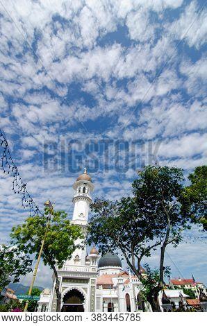 Georgetown, Penang/malaysia - Feb 14 2020: Minaret Kapitan Keling Mosque Under Blue Sky.