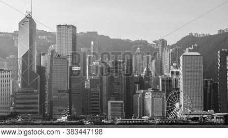 Hong Kong, Hong Kong - December 10: Black And White Tone Sea Front View With Luxurious Buildings In