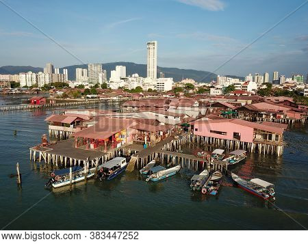 Georgetown, Penang/malaysia - Feb 28 2020: Aerial View Boats Anchor Near The Wooden Bridge Of Tradit