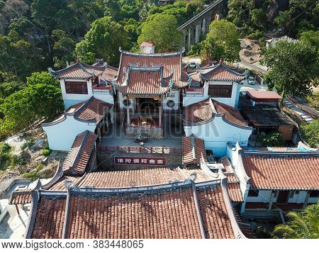Georgetown, Penang/malaysia - Feb 28 2020: Aerial View Thien Kong Than Temple And Green Trees Surrou