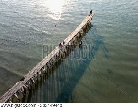Georgetown, Penang/malaysia - Feb 29 2020: Aerial View Look Down Wooden Bridge With Shadow At Clan J