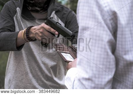 A Murderer, Terrorist Attacking Holding Gun Kidnapping Business Young Man For A Hostage Robbery And