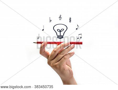 Hand Held Pencil With Note Music Isolated On White Background, Creativity