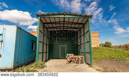 A Large Metal Industrial Warehouse For Storing Goods For Storing Goods. Industrial Concept Of Transp