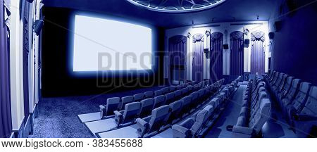 Cinema Theater Screen In Front Of Seat Rows In Movie Theater Showing White Screen Projected From Cin
