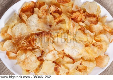Close Up Home Made Potato Chips. In Plate