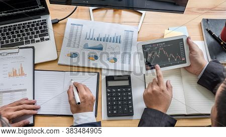 Business Team Investment Working With Computer, Planning And Analyzing Graph Stock Market Trading Wi